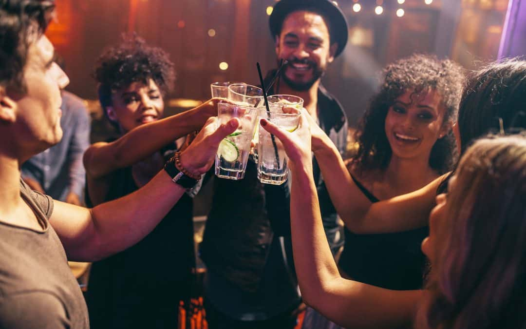 Friends Drinking in Club - Signs of Alcoholism